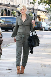Gwen Stefani brought her funky-chic style to the streets of London with this army-green jumpsuit.
