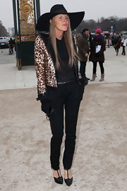 Anna dello Russo brought major glitter to the Viktor & Rolf fashion show with this Saint Laurent leopard sequined jacket.