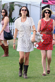 Camilla Belle tied her festival ensemble together with a white satchel by Coach.