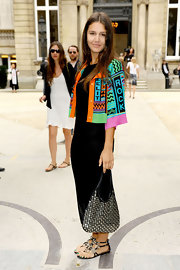 Margherita Missoni paired her bright ensemble at the Valentino Haute Couture show with a black leather bag covered in silver studs.