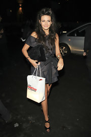 A gray suede clutch with a ruffled flap complemented Michelle Keegan's cute frock.