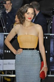 Marion Cotillard sported a stylish blend of colors with this red croc-embossed clutch and tricolor dress combo at the 'Dark Knight Rises' premiere.