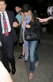 Jennifer Aniston finished off her airport look with a lavender silk scarf.