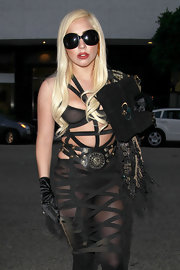 Lady Gaga teamed a studded Versace belt with a harness dress for her dominatrix-inspired look.