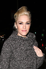 Gwen Stefani looked funky with her pompadour ponytail as she left Milk Studios.