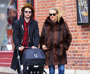 Sienna Miller stepped out for a stroll wearing a brown faux-mink coat by Ruby + Ed.