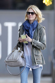 January Jones styled her casual outfit with a blue scarf for a day out in Hollywood.