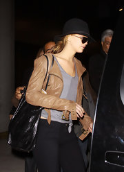 Jennifer Lawrence was incognito in a tan leather jacket, a pair of aviators, and a hat as she arrived on a flight at JFK.