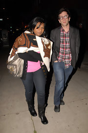 Mindy Kaling stayed warm with a printed shawl while enjoying a night out in West Hollywood.