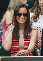 Pippa Middleton flashed a smile in her sunnies at the Wimbledon Tennis Championships.