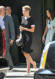 Miley Cyrus paired her LBD with simple white pumps by Celine.