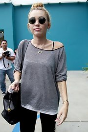 Miley Cyrus styled her outfit with a crescent-shaped diamond necklace by Jacquie Aiche.