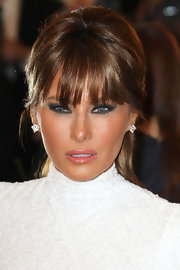 Melania Trump accentuated her exotic eyes with smoky makeup.