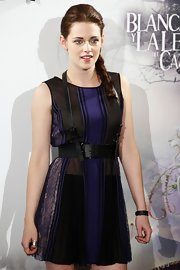 Kristen Stewart gave her mini dress a dose of edge with a black harness belt for the 'Snow White and the Huntsman' photocall in Madrid.