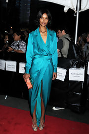 Liya Kebede teamed her wrap dress with a pair of Art Deco-chic silver peep-toes.