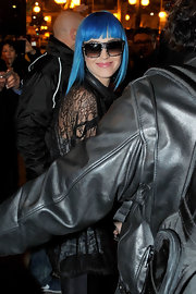 Katy Perry accessorized with a pair of oversized rectangular shades for a night out in Paris.
