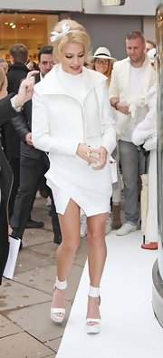Pixie Lott arrived for the new Blackberry launch sporting an all-white cropped jacket, dress, and sandals combo.
