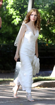 A pair of silver T-strap sandals completed Anna Kendrick's wedding scene costume.