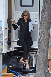 Jennifer Aniston was spotted on the set of 'Squirrels to the Nuts' looking chic in a black Burberry trenchcoat.