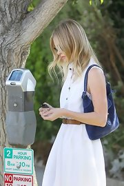 Kate Bosworth stopped by Planet Nails sporting a blue suede hobo bag and white shirtdress combo.