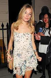 On the other wrist, Sienna Miller sported a chic silver cuff.