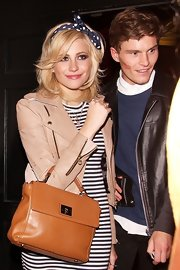 Pixie Lott went clubbing wearing a nude leather jacket over a striped dress.