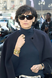 Ines de la Fressange stacked multiple gold bangles at the Giambattista Valli Fall-Winter show.