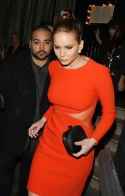 Jennifer Lawrence carried a red carpet-worthy black hard-case clutch while out having dinner in London.