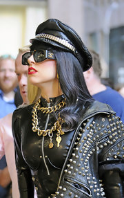 Lady Gaga teamed a layered chain necklace with a studded jacket and a military cap for a super-edgy look during her visit to the Sirius radio studios.
