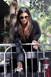 Camila Alves tried to keep a low profile with a pair of square shades while visiting an amusement park.