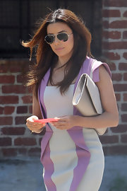 Eva Longoria kept her eyes hidden behind a pair of Michael Kors aviators.