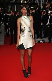 Liya Kebede went the modern route at the 'Cosmopolis' premiere in a Proenza Schouler peacock-embroidered halter dress with a black mesh hem underlay.