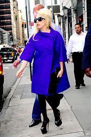 Lady Gaga cut an elegant figure in an electric-blue swing coat by Christian Dior while shopping in New York City.