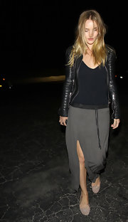 Rosie Huntington-Whiteley added a youthful touch with a pair of taupe ballet flats.