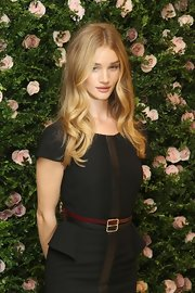 Rosie Huntington-Whiteley dressed up her LBD with a two-tone leather belt for the launch of her lingerie collection.