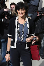 Ines de la Fressange accessorized her smart chic outfit with a multi-strand beaded Chanel necklace.