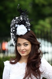 Aishwarya Rai paired her 'do with a flower-adorned black-and-white hat.