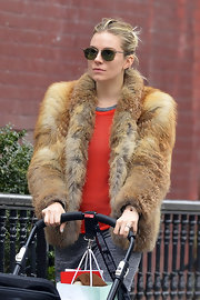 Sienna Miller hid her eyes behind a pair of oval shades while out on a stroll.