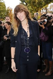 Lou Doillon attended the Chanel fashion show rocking an oversized pendant necklace from the brand.