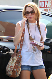 Miley Cyrus grabbed breakfast out in Toluca Lake carrying a tribal-chic shoulder bag.