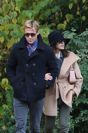 Ryan Gosling bundled up in a navy blue wool coat as he braved the Paris chill with Eva Mendes