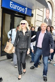 Gwen Stefani was her usual funky self in a charcoal denim pantsuit while out and about in London.