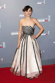 Marion Cotillard donned a light pink with black stripes Dior Couture gown for the 38th Cesar Film Awards.