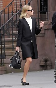 Kate Bosworth paired her coat with a stylish black bowler bag.