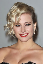 Pixie Lott's pop of red lipstick looked striking against her alabaster skin.