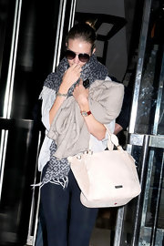 Rosie Huntington-Whiteley was spotted at her Manhattan hotel all bundled up in a geometric-patterned scarf.