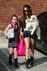An oversized Hello Kitty clutch rounded out Noah Cyrus' attire.