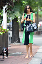 Famke Janssen left Bar Pitti carrying a patent leather tote on one hand and holding her pet's leash in the other.