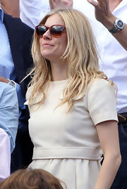 Sienna Miller looked chic in her wayfarers while enjoying a French Open match.