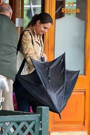 Katie Holmes stepped out on a rainy day in New York City carrying a black stick umbrella.